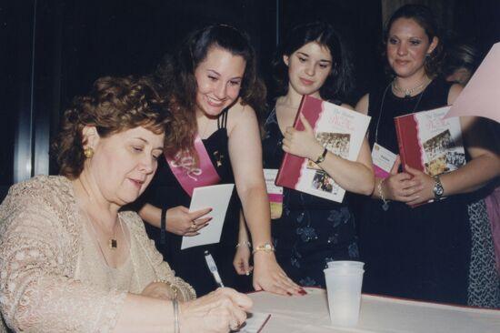 Mary Jane Johnson Signing Copies of The History of Phi Mu Photograph, 2002 (image)