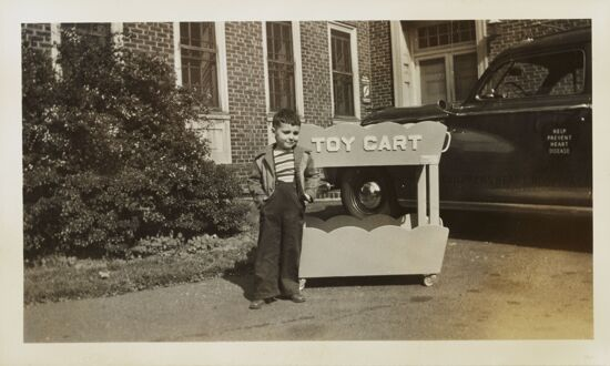 Boy with Toy Cart Outside Children's Heart Hospital Photograph, 1947-48 (image)