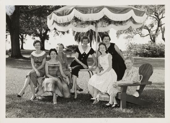 Group of Seven Under Umbrella at Convention Photograph, June 24-30, 1956 (image)