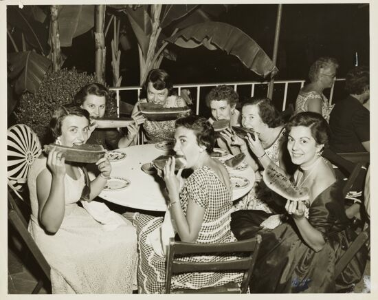 Convention Attendees Eating Watermelon Photograph, 1954 (image)