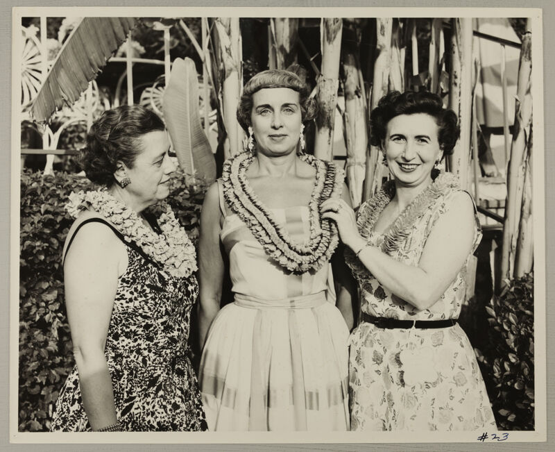 Unidentified, Freear, and Watson in Leis at Convention Photograph, July 11, 1954 (Image)