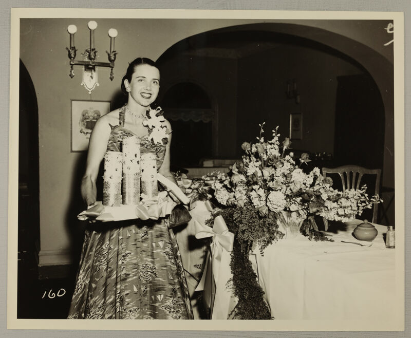 Unidentified Phi Mu Carrying Candles at Convention Photograph, July 11-16, 1954 (Image)