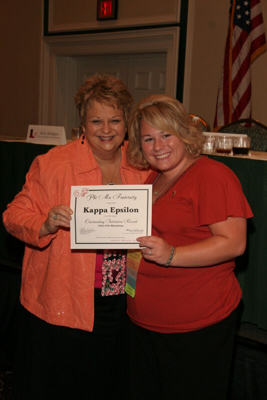 Kathy Williams and Kappa Epsilon Chapter Member With Certificate at Friday Convention Session Photograph 2, July 14, 2006 (Image)