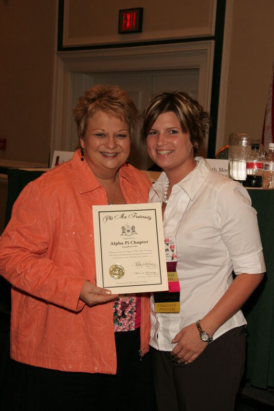 Kathy Williams and Alpha Pi Chapter Member With Certificate at Friday Convention Session Photograph 2, July 14, 2006 (Image)