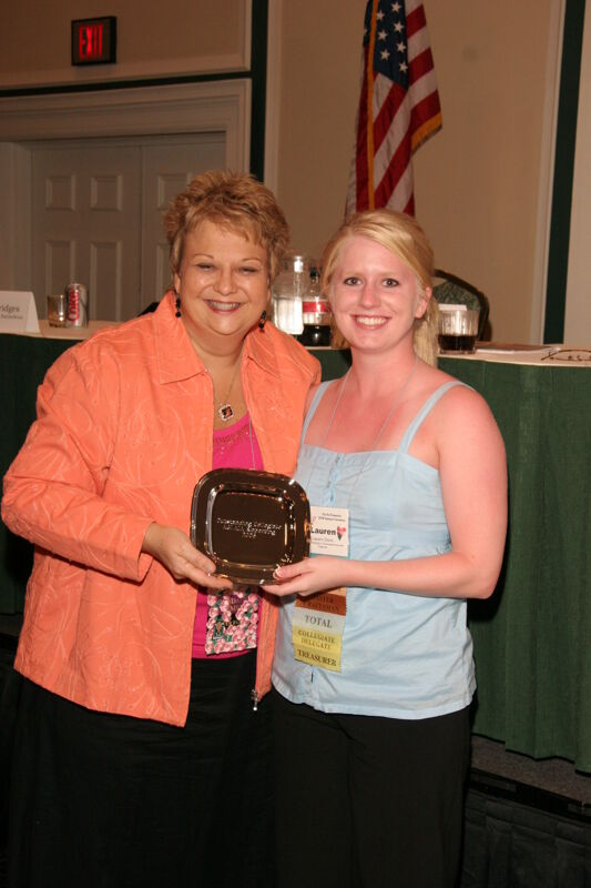 Kathy Williams and Lauren Davis With Award at Friday Convention Session Photograph 2, July 14, 2006 (Image)