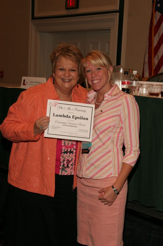 Kathy Williams and Lambda Epsilon Chapter Member With Certificate at Friday Convention Session Photograph 2, July 14, 2006 (Image)