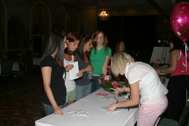 Four Phi Mus at Convention Registration Table Photograph, July 2006 (Image)