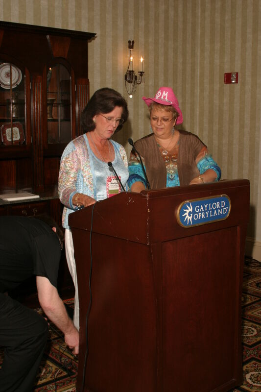 Shellye McCarty and Kathy Williams at Podium During Convention Officer Luncheon Photograph, July 2006 (Image)
