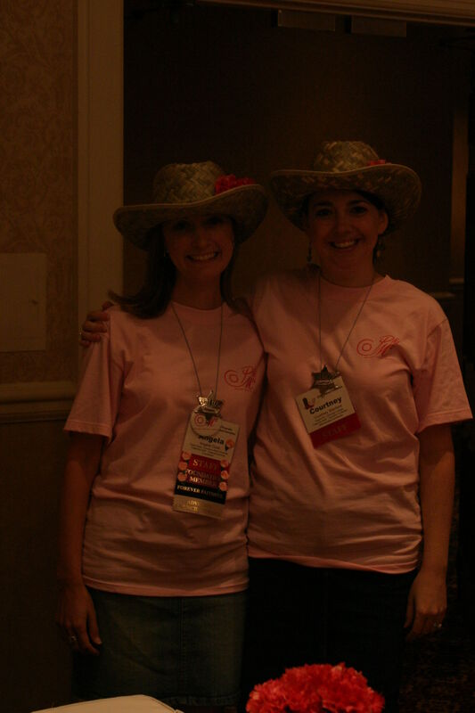 Angela Cook and Courtney Stanford in Hats at Convention Registration Photograph 1, July 2006 (Image)