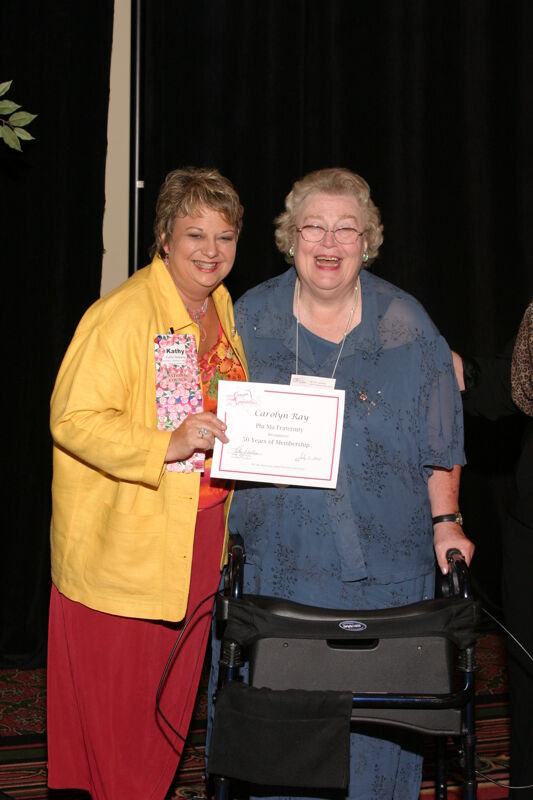 Kathy Williams and Carolyn Ray With Certificate at Convention Sisterhood Luncheon Photograph, July 8-11, 2004 (Image)